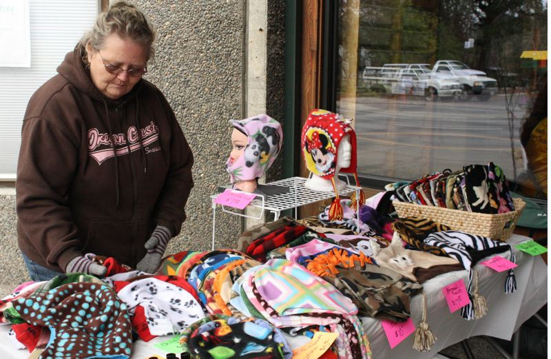 by: POST PHOTO: JIM HART - POST PHOTO: JIM HART Joyce Wright of Eagle Creek adjusts her sale items to fit the climate and season. In this photo, taken during the March First Saturday market in Sandy, Wright arranges an assortment of handmade fleece hats and purses that she created using her original patterns with animal faces and lots of color. As operator of Wright´s Nursery in Eagle Creek, Wright is likely to bring to the April 6 market some potted plants and fruit and shade trees. And if everything goes according to plan, she said, also some veggie starts. Market Coordinator Carol Cohen says at the April 6 market she will have food, photographs, birdhouses, plants and more. The market is located at the AEC building, 39085 Pioneer Blvd., and is held from 10 a.m. to 3 p.m. Cohen is still taking vendors for each market. For information or to become a vendor, call Cohen at 503-475-2347 or email ccohen@cityofsandy.com.