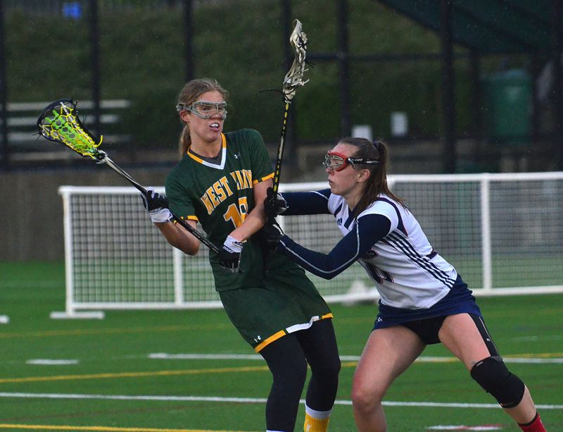 by: VERN UYETAKE - Mariah Gatti and and the West Linn girls lacrosse team were the runners up at state last year and hope to reach the title game again.