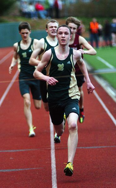 by: DAN BROOD - Roman Ollar is part of a strong distance corps for the West Linn boys track team this year.