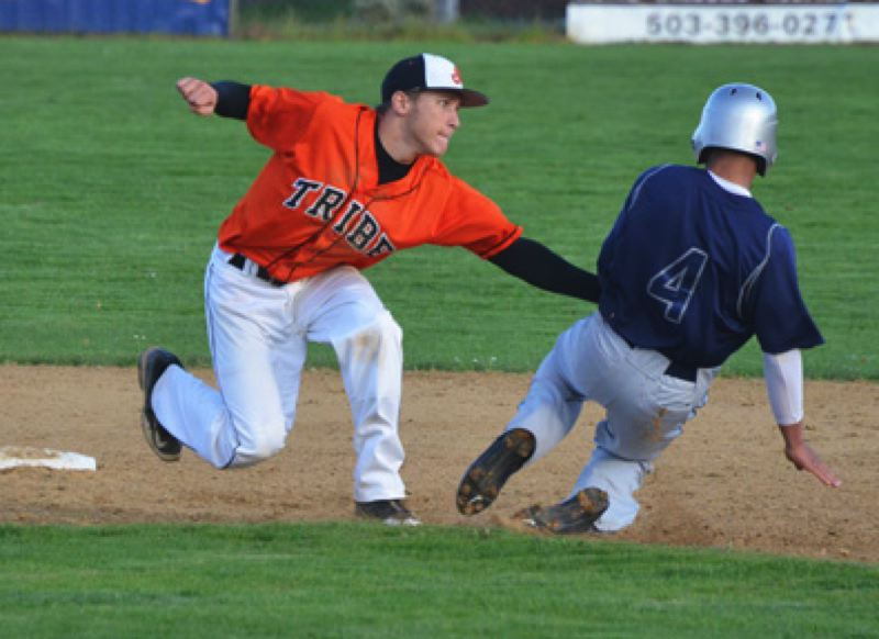by: JOHN BREWINGTON - GOTCHA. Scappoose's Hunter Hoyt tags out a Banks runner attempting to steal late in Tuesday's game with Banks. The Indians posted a 4-2 win in the Cowapa League opener.