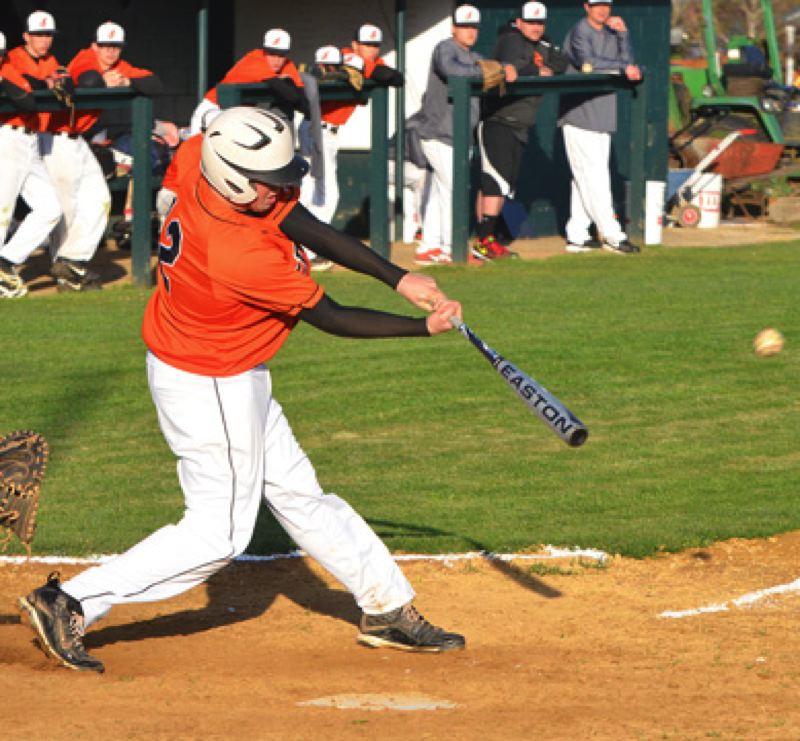 by: JOHN BREWINGTON - Scappoose's Will Sprute banged out this ball for a three-run double in Tuesday's game with Banks.