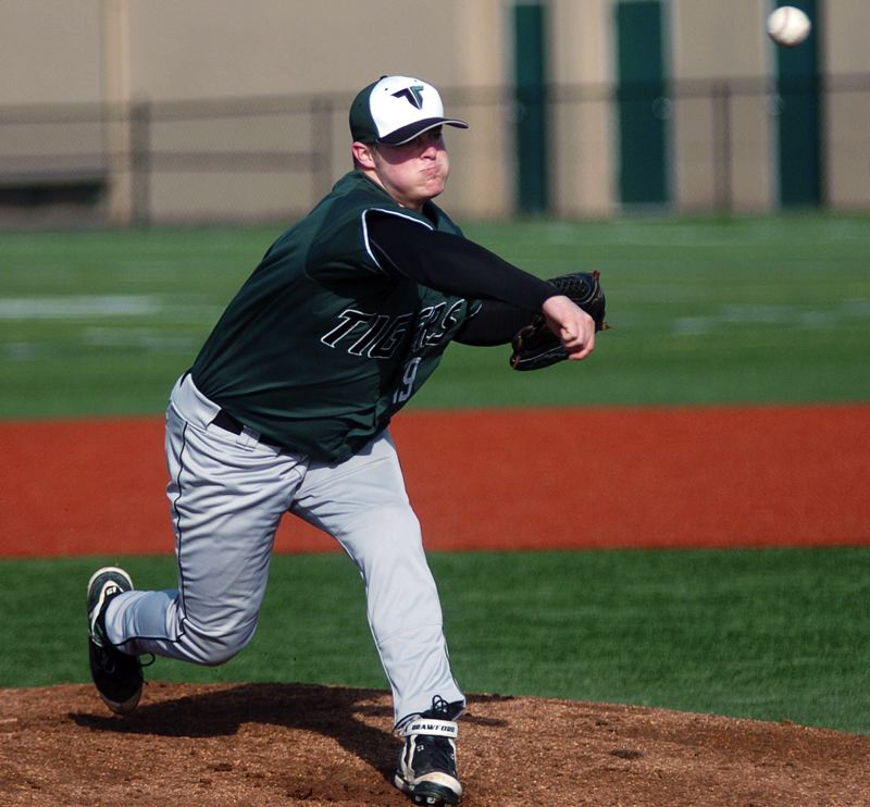 by: DAN BROOD - COMING UP BIG -- Tigard High School junior Jake Biglow could be part of a strong Tiger pitching staff going into Pacific Conference play this season. Biglow also should se action at first base.