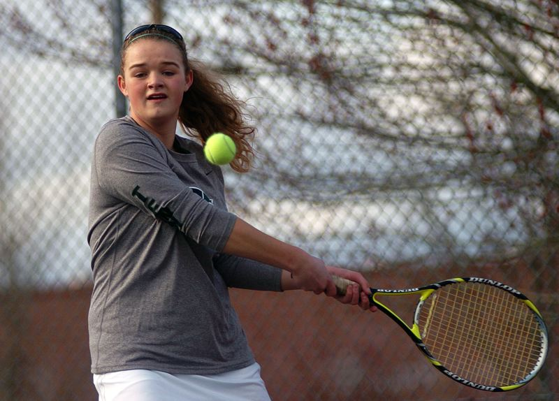 by: DAN BROOD - BIG BACKHAND -- Junior Courtney Roshak will play at No. 2 singles for the Tigard High School girls tennis team this season.
