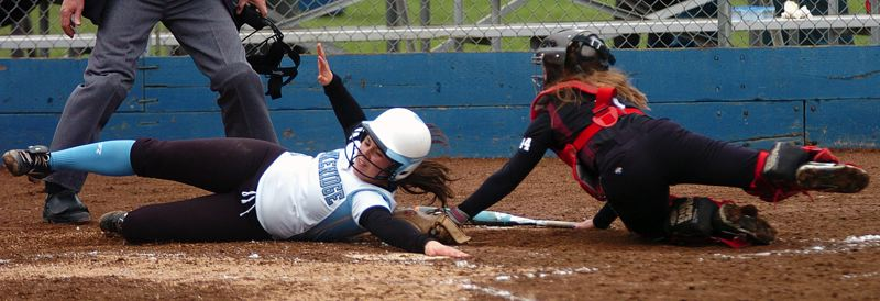 by: DAN BROOD - Lakeridge's Erica Saporito tries to avoid a tag at the plate in the Pacers' win over Sherwood.