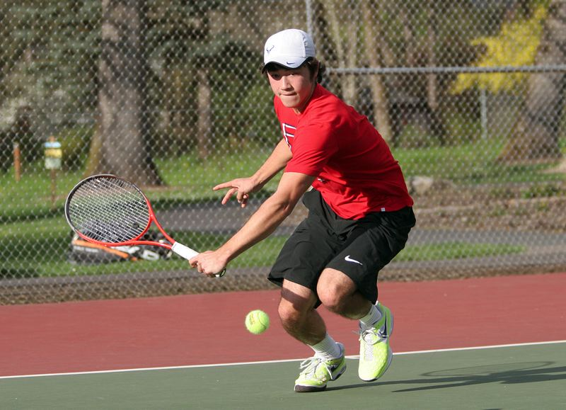 by: MILES VANCE - GOT IT - Southridge junior Andy Nakajima races to make a return during his three-set victory over Sunset's Brian McKittrick in their first singles match at Camille Park on Monday.