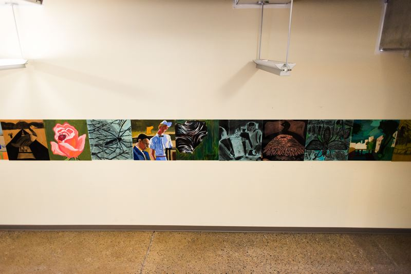 by: HILLSBORO TRIBUNE PHOTO: CHASE ALLGOOD - Student art adorns the wall connecting to the construction area at Building 9, PCC Rock Creek campus.
