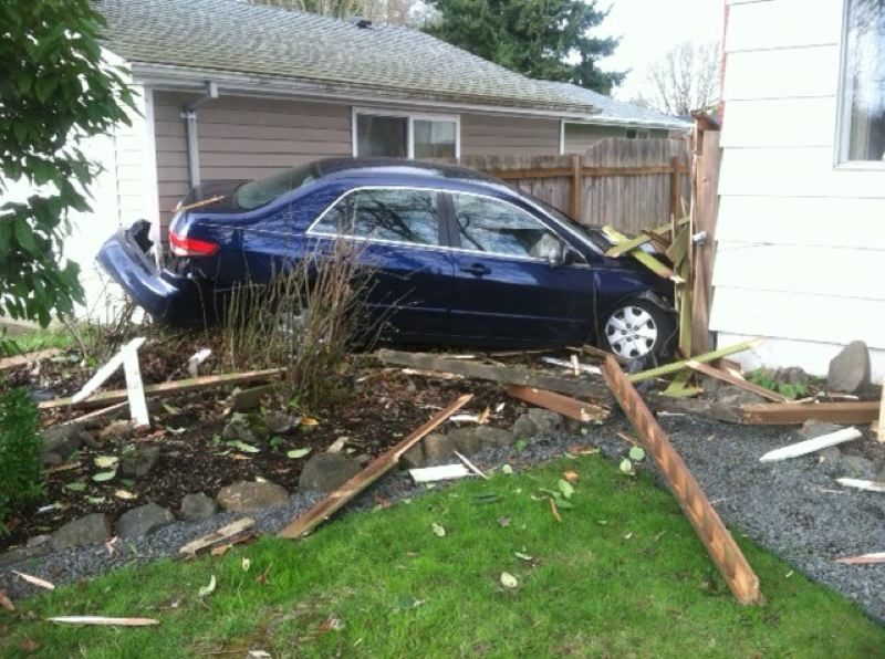 by: COURTESY OF WASHINGTON COUNTY SHERIFF'S OFFICE - Kimberly Veed was the second alleged drunk driver to crash into these homes in two days.