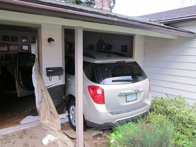 by: WASHINGTON COUNTY SHERIFFS OFFICE - No one was injurd when this SUV crashed into a house Sunday.