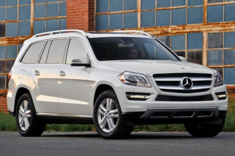 by: DAIMLER AG - The 2013 Mercedes-Benz GL350BTC is bigger than before but still handles well and gets respectable mileage.