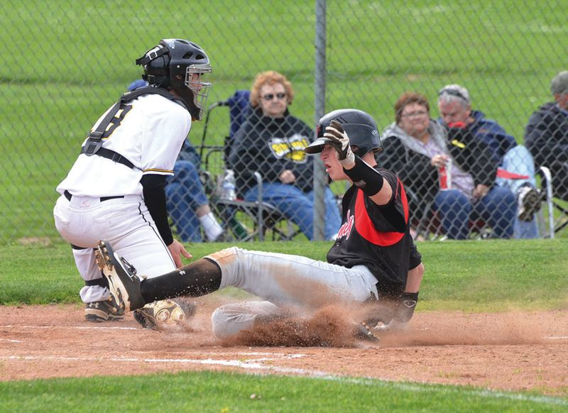 by: SANDY POST: JOHN BREWINGTON - Daymond Fritsch slides safely home with the teams first run during Tuesdays 2-1 win at St. Helens.