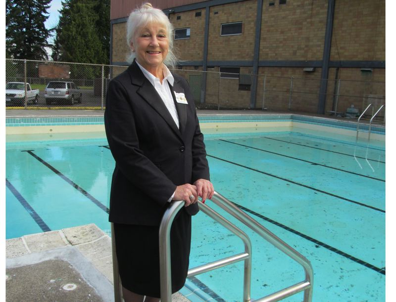 by: PHOTO BY ELLEN SPITALERI - Mary Anne Paradise, former Exalted Ruler of the Milwaukie Elks Lodge, stands next to the swimming pool that she hopes to see open for members in June.