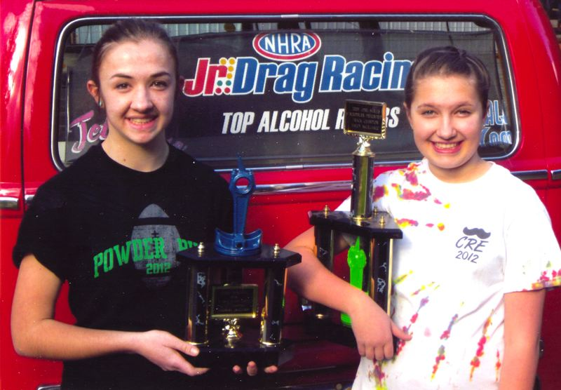 by: CONTRIBUTED PHOTO - Haley and Jessie Skerjanec show off their hard-earned trophies.