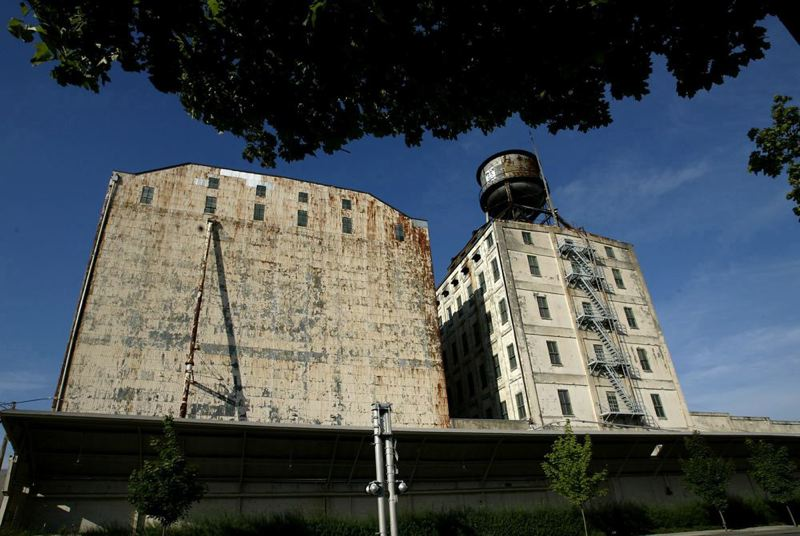 by: TRIBUNE FILE PHOTO - Developer Jordan Schnitzer's Harsch Investment Properties plan to redevelop  the Centennial Mills property on the Willamette riverfront.