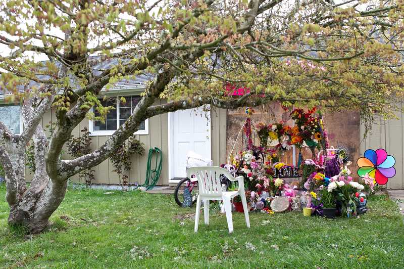 by: TIMES PHOTO: JAIME VALDEZ -  Community members continue to add flowers and decorations to a memorial for Kylie Hornych in front of her home.