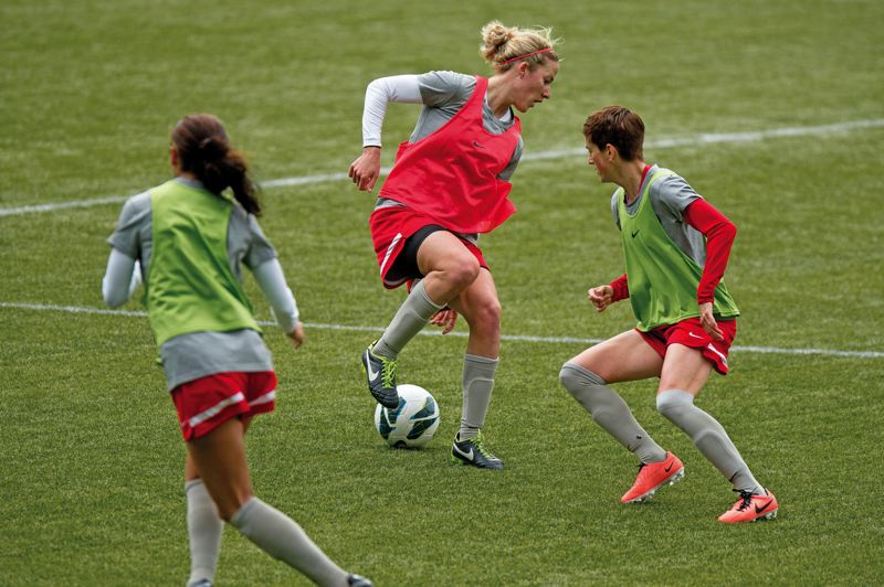 by: TRIBUNE PHOTO: CHRISTOPHER ONSTOTT - Portland's new women's professional soccer team, the Thorns, ran through drills Sunday morning at Jeld-Wen Field.