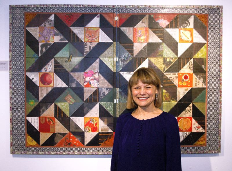 by: ESTACADA NEWS ISABEL GAUTSCHI - Artist Nine Bradford stands in front of her 'Friendship Quilt' collage.