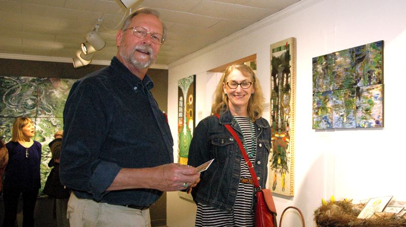 by: ESTACADA NEWS ISABEL GAUTSCHI - Steven and Martha Amick enjoy First Friday at the Spiral Gallery in Estacada.