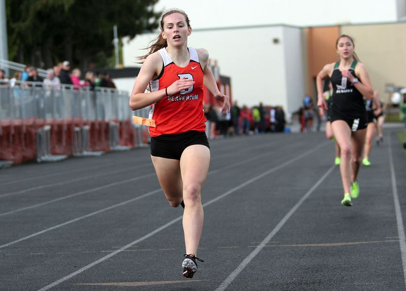 by: MILES VANCE - BIG WIN - Beaverton sophomore Allie Mueller hits the home stretch in her victory in the 1500 meters against Jesuit last week.