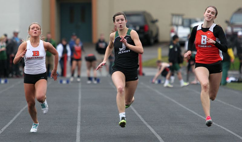 by: MILES VANCE - HIGH SPEED - Jesuit's Alexa Dixon (center) runs to victory in the 100-meter dash against Beaverton's Molly Mutz-McCay (left) and Caitlin Anderson at Beaverton High School on April 3.