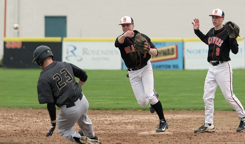 by: MILES VANCE - FOR TWO - Beaverton sophomore shortstop Casey Cornwell turns a double play with Southridge senior Chandler Whitney sliding in and senior teammate Ryan Cowley backing up the play at Beaverton High School on Tuesday.