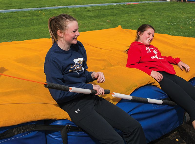 by: NEWS-TIMES PHOTO: CHASE ALLGOOD - Banks junior high jumpers Amy Hilger (left) and Lauren Birr share a laugh during practice on Monday afternoon. Both girls qualified for last year's OSAA Class 4A state meet.