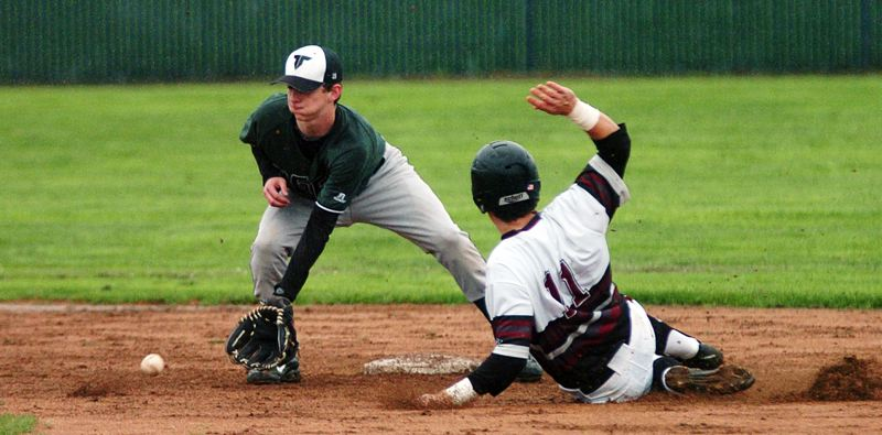 by: DAN BROOD - RIVALS IN ACTION -- Tigard junior second baseman Bruin Campbell (left) looks to scoop up the ball as Tualatin senior Austin Marsh steals second base in Friday's game.