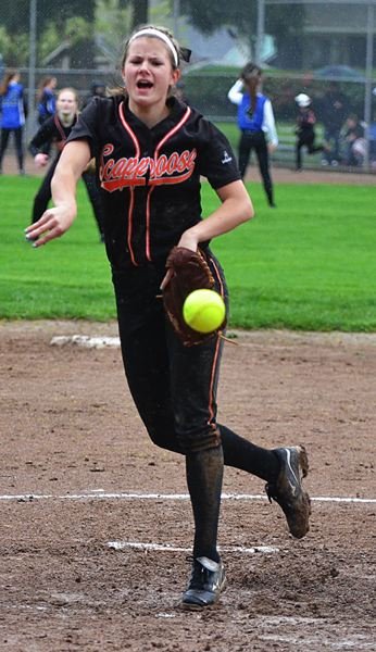 by: JOHN BREWINGTON - Scappoose's Lacey Updike gave it a good shot in the rain against Grant last Friday, but the game was called with the Lady Indians leading the 6A squad, 5-4.