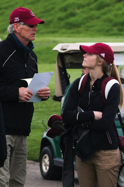 by: HILLSBORO TRIBUNE PHOTO: CHASE ALLGOOD - Glencoe junior Chelsea Plinke, who spent last year studying abroad in France, confers with head golf coach Mark Ferris during Tuesday's conference tournament.
