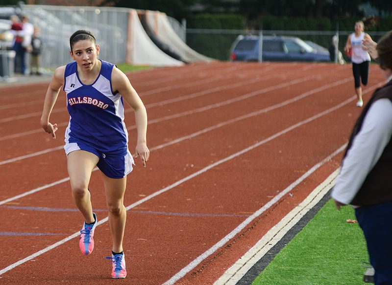 by: HILLSBORO TRIBUNE PHOTO: CHASE ALLGOOD - Hillsboro junior Lauren Lykins leans across the finish line during her victory in the 800 meters at last Wednesday's dual meet against Century.