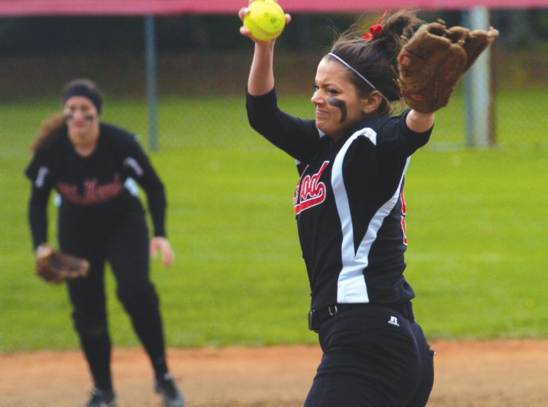 by: THE OUTLOOK: DAVID BALL - Saints pitcher Anne-Marie Guischler winds up during a complete-game effort in Game 1 Saturday. She finished with 11 strikeouts.