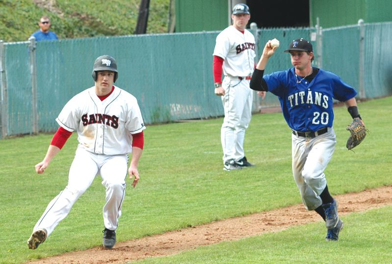 by: SANDY POST: PARKER LEE - Mt. Hoods Jake Thran tries to escape a run down on the third-base line Thursday against Lane CC.