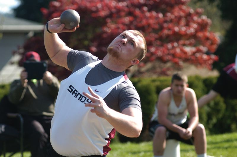 by: SANDY POST: DAVID BALL - Sandys Kevin TenEyck lets loose with his final throw in the shot put which vaulted him to the top of the leader board.