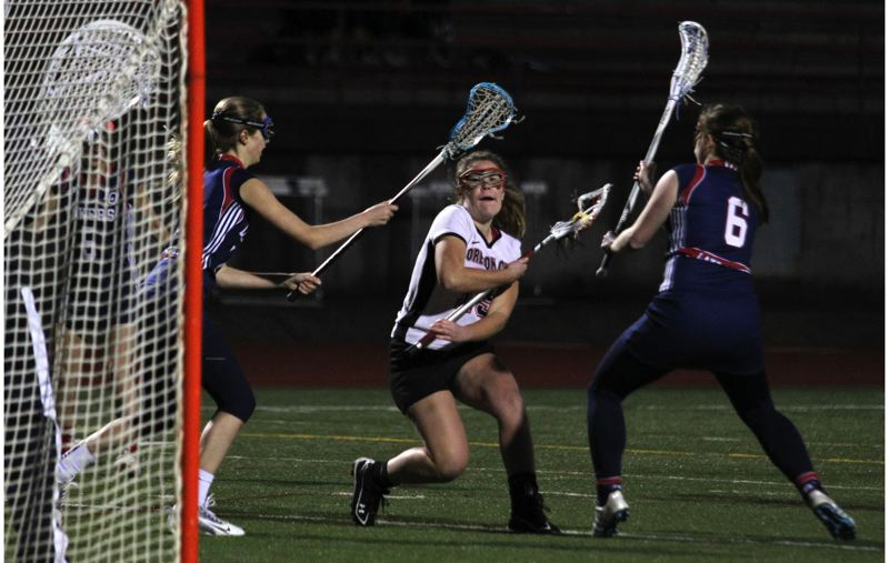 by: JONATHAN HOUSE - Oregon City senior midfielder April Lanz goes on the attack in last weeks upset of top-ranked Lake Oswego. Lanz scored three goals and made two assists in the Pioneers 10-8 victory.