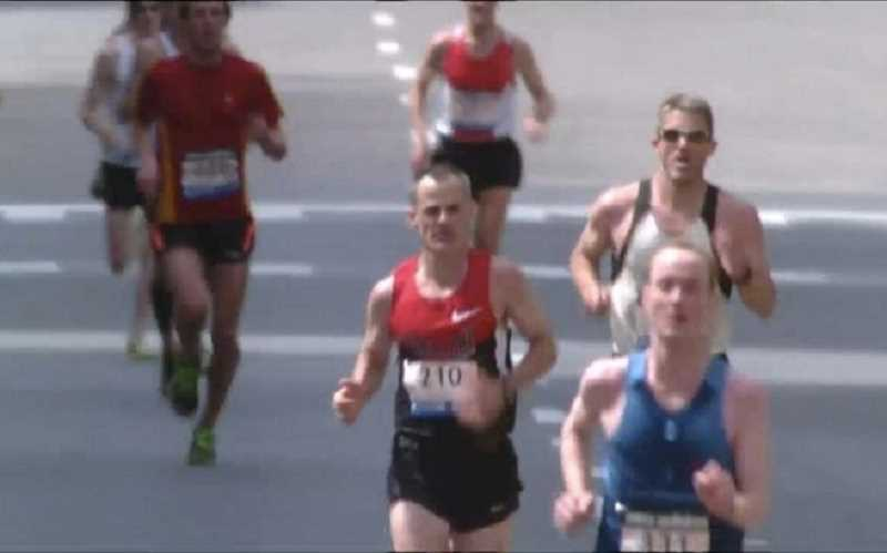 by: COURTESY PHOTO, APRIL 15, 2013 - Dave Harkin (number 210) owns Portland Running Company. He finished the Boston Marathon before two explosions near the finish line.