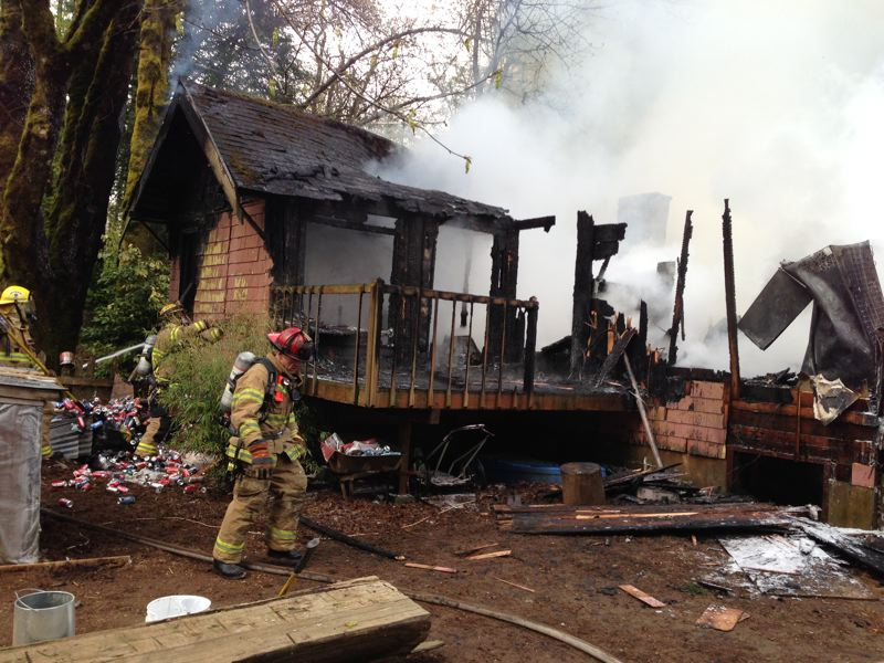 by: TUALATIN VALLEY FIRE AND RESCUE - Water tenders from multiple fire districts, including Scappoose, manage the scene of a house fire on rural Dixie Mountain Road. The house had nearly been consumed by the time the responders arrived.