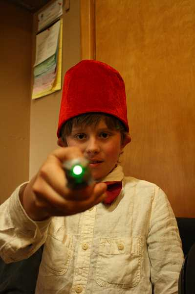 POST PHOTO: NEIL ZAWICKI Benjamin Collins, a sixth-grader at Oregon Trail Primary Academy, chose to attend the school for its high academic standards. He plans to attend Cambridge University, and, as indicated through the hat and wand, is keen on Dr. Who.