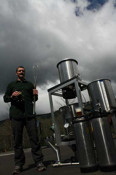 Sandy resident Tom Gall stands next to fellow craft brewer Todd Churchill's beer sculpture, a high-end brewing apparatus that allows for computer-controlled mixing and temperature. Gall conceived of the idea to make brewer's yeast the official state microbe. The bill passed the House by a 58-0 vote last week. POST PHOTO:  NEIL ZAWICKI