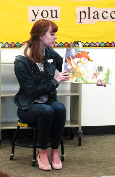by: OUTLOOK PHOTO: LISA K. ANDERSON - Cleveland High School drama students Brookelin McKay and Eleanor Herreid-O´Neil, juniors, read to families at Troutdale Library in honor of Fair Housing Month. They were accompanied by their teacher, Jane Ferguson.