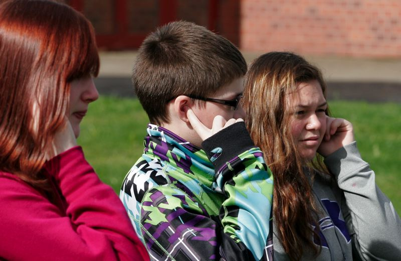 by: OUTLOOK PHOTO: JIM CLARK - Gordon Russell Middle School students hold their ears as re-inactors fire a canon.