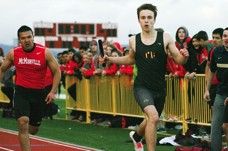 by: NEWS-TIMES PHOTO: AMANDA MILES - Forest Grove sophomore Levi Boyer celebrates at the finish line on the anchor leg of the Vikings' winning 4x400-meter relay last Wednesday in a conference dual meet against McMinnville.