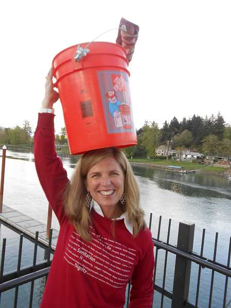 by: CLIFF NEWELL - Linda Favero knows how to use her head when it comes to Walk4Water. Favero and 400 other water walkers will be raising money for Zambians who badly need water.