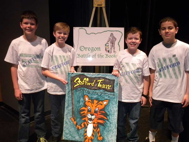 by: SUBMITTED PHOTO - The Stafford Battle of the Books team poses with a team poster at the state finals.