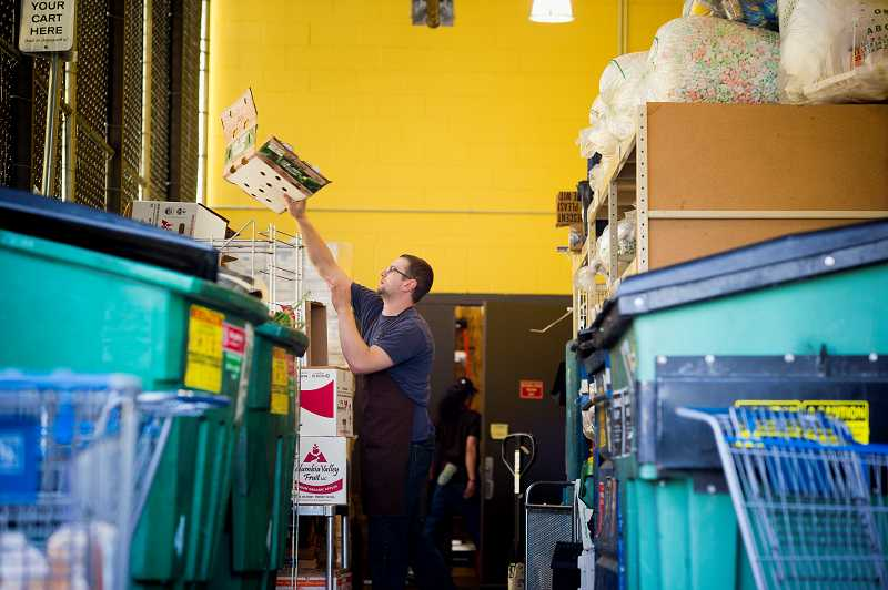 by: TIMES PHOTO: CHRISTOPHER ONSTOTT - New Seasons employees separate out all the waist into different bins such as cardboard, compost, Styrofoam, rigid plastic, cans and bottles and stretchy plastic at their Progress Ridge store in Southwest Beaverton.