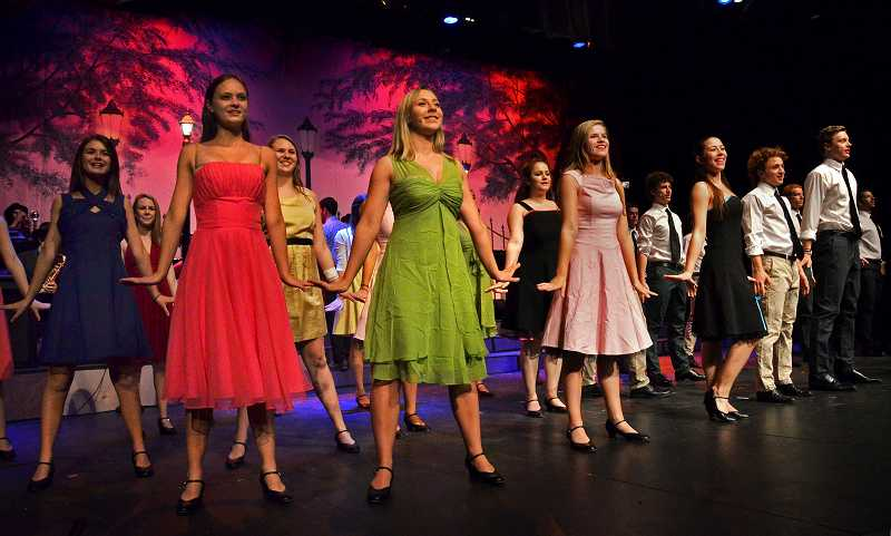 by: STAFF PHOTO: VERN UYETAKE - Lakeridge's Company show group and the stage band perform 'Something's Coming/Tonight.'