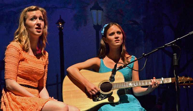 by: PHOTO: VERN UYETAKE - Mandy Wade, left, and Megan Mandel perform 'Landslide.'
