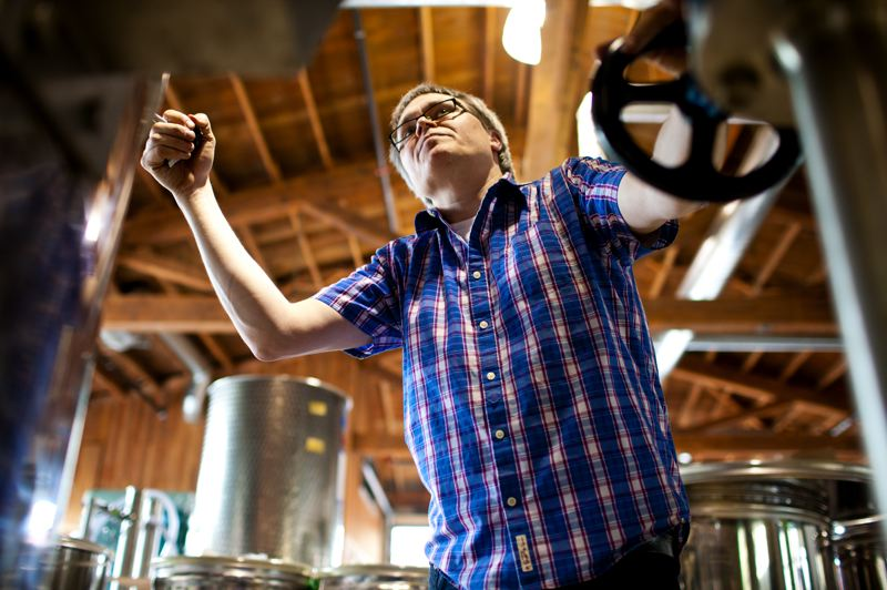 by: TRIBUNE PHOTO: CHRISTOPHER ONSTOTT - Tom Burkleaux, owner of New Deal Distillery, adjusts a steam valve while keeping a close eye on his still, used for making gin and vodka. New Deal handcrafts its spirits starting with the grain.