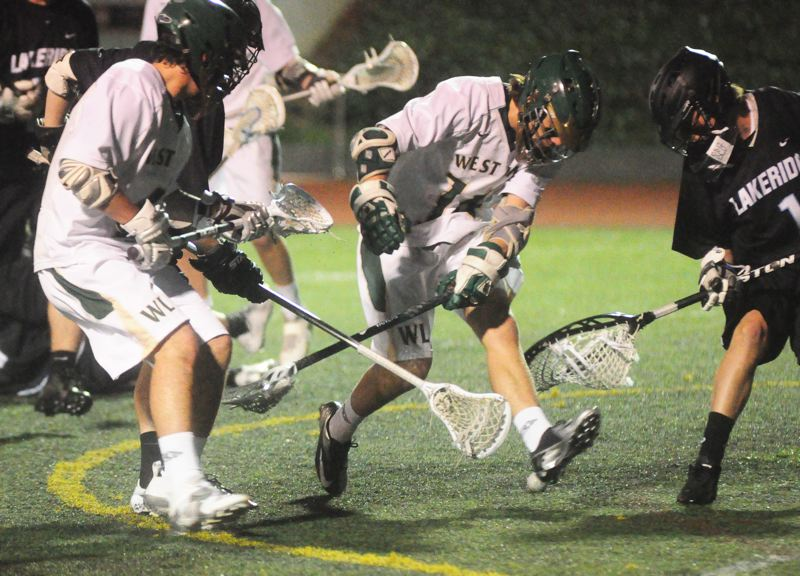 by: MATTHEW SHERMAN - West Linn's Drew Crowther tries to track down a ground ball near the Lakeridge net in the Lions' 10-6 loss to the Pacers last week.