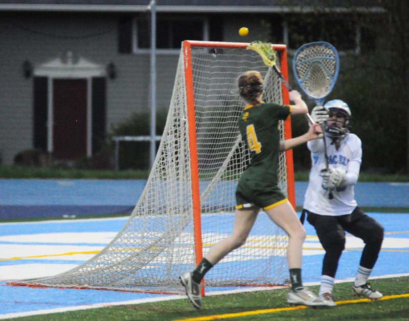 by: MATTHEW SHERMAN - West Linn's Hanna Morford tosses in one of her three goals during last week's lopsided victory over Lakeridge.