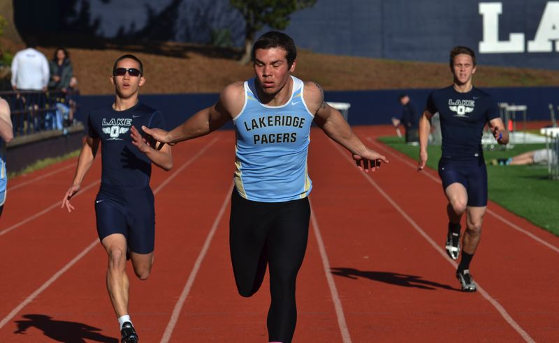 by: VERN UYETAKE - Lakeridge's Alex Alamida crosses the finish line in the 200 meters in last week's Civil War track meet. Alamida won both the 100 and the 200.