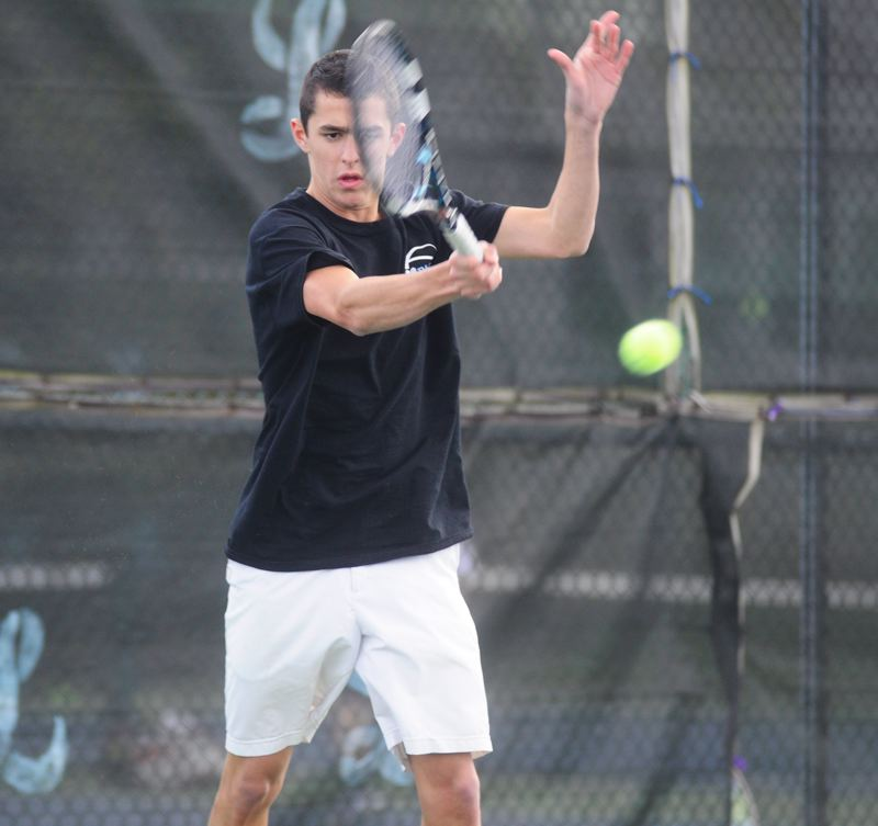 by: MATTHEW SHERMAN - Lakeridge's Bruno Homedes makes a return during his straight sets victory at No. 1 singles for the Pacer boys tennis team in its match with Lake Oswego.